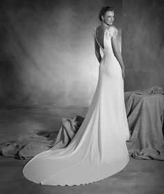 Naomi - Wedding dress with a bateau neckline, gemstones and feathers