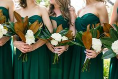 Magnolia bridesmaids bouquets with matching strapless dark green gowns at Cannon Green | Nickie Stone Photography