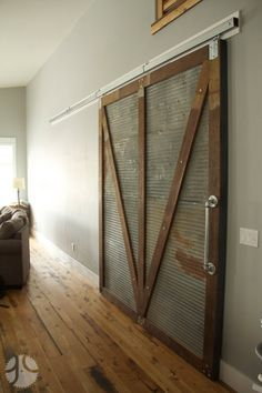 barn door with corrugated sheet metal   ... mount on reclaimed corrugated metal from Grain Designs in Fargo ND