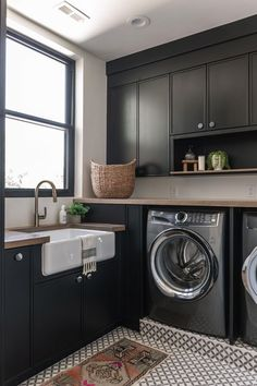 In the laundry room of our Summit Creek Project, we chose to paint the cabinetry black. Black is a neutral with a bit of edge. In this space we used it with Old World cement tile, beautiful wood counters, and woven textures that add color and pattern. Laundry Room Cabinets, Laundry Room Organization, Laundry Room Design, Sink In Laundry Room, Organizing, Laundry Room Colors, Laundry Drying, Laundry Closet, White Laundry Rooms