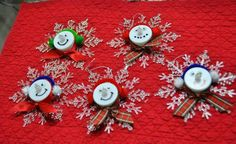 Tea lights, snowflake ornaments, pipe cleaners, Christmas pompoms, ribbon, googly eyes, hot glue, pens