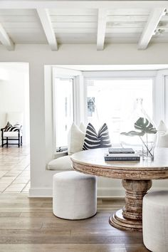 A Los Angeles Home That Perfectly Mixes Classic and Serene bright white dining room with round table and built in bench seating Home Interior Design, Dining Room Design, Minimalist Dining Room, House Interior, White Dining Room, Home, Interior, Minimalist Home Decor, Home Decor