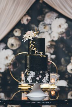 black and gold wedding cakes - photo by Ed and Aileen Photography http://ruffledblog.com/dutch-floral-still-life-wedding-inspiration