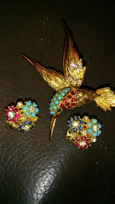 Check out this item in my Etsy shop https://www.etsy.com/it/listing/252332011/ciner-marcel-boucher-earrings-brooch-set