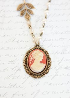Coral Lady Cameo Necklace Cameo Pendant Ivory by apocketofposies.  Gorgeous.  Would go nicely with my antique cameo ring!