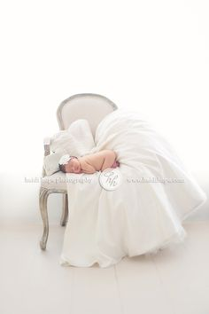 Newborn on moms wedding dress. That's adorable but I would NOT be putting a naked baby on my wedding dress. Baby will be wearing a diaper. lol
