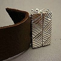 Learn how to make leather jewelry at Nina Designs - where beautiful jewelry begins. Find leather for jewelry, silver clasps, and silver charms at Nina Designs - all original designs!