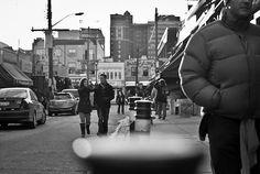 Couple strolling through Kensington Market in Toronto, Ontario.