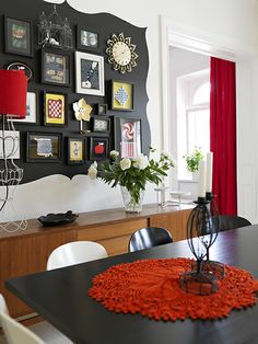 Love this idea! Paint a black design/backdrop to display pictures and art.