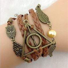 Features the Deathly Hallows logo, Snitch Wings and Hedwig. This charming bracelet makes the perfect gift for any Harry Potter fan in your life! Great gift for Harry Potter fans. Bracelet Harry Potter, Harry Potter Armband, Harry Potter Schmuck, Bijoux Harry Potter, Harry Potter Magic, Harry Potter Deathly Hallows, Personalized Bracelets, Handmade Bracelets, Bracelets For Men