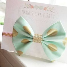Check out this item in my Etsy shop https://www.etsy.com/listing/205135452/mint-and-gold-dot-fabric-hair-bow-on