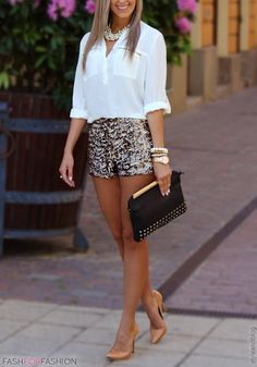 Embellished shorts, white button up blouse, tan heels, pearl necklace, bracelets, and black clutch.