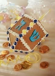 gingerbread dreidel. Alot easier than a gingerbread house.  Make more than one at a time.