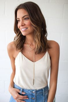 Bohme's Brooklyn Tank features a soft v neckline, loose body, and spaghetti straps. This top is perfect for summer picnics and looks great under a denim jacket!