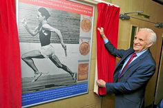 Walsall-born runner Peter Radford with a picture of himself running at Aldersley…