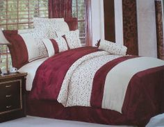 QUEEN size Burgundy and Beige with Embroidery Strip Comforter Set by octorose. $49.99. Care: Machine Wash Cold. Material: Polyester with embroidery. Color: Burgundy, Beige. Size: Queen. The package includes 7 Piece designer Style Comforter Set bedding in a bag.  Comforter, Dust Ruffle, Neck Roll, Cushions (2), and Shams (2)    Reinvent your bedroom with this refreshingly vivid pattern. The designer style modern comforter set will infuse fashionable ambiance to you...