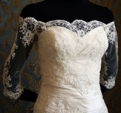 I don't really believe this is a 'bolero', but there doesn't seem like a better name for it. Regardless, LOVE! Perfect compromise between sleeves, strapless gown, and not covering up the neckline!