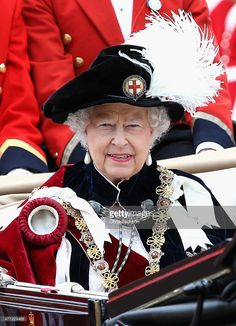 Queen Elizabeth II leaves the Order of the Garter Service at St George's Chapel in a royal carriage at Windsor Castle on June 15, 2015 in Windsor, England. The Order of the Garter is the most senior and the oldest British Order of Chivalry and was founded by Edward III in 1348.  (Photo by Chris Jackson - WPA Pool /Getty Images)