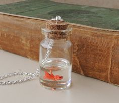 Hey, I found this really awesome Etsy listing at http://www.etsy.com/listing/102032426/goldfish-bottle-necklace-miniature-fish