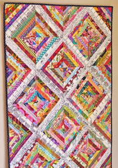 Scrappy Quilt ... simply luscious!   She has also included TONS of links to other scrappy quilts to drool over!