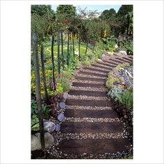 GAP Photos - Garden & Plant Picture Library - Garden path made from old railway sleepers with gravel fill in - GAP Photos - Specialising in horticultural photography
