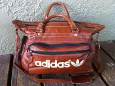 This fantastic vintage (1970s?) Adidas gym bag/satchel is is GREAT condition! Made of faux leather and measures aprox. 15 inches wide by 12 inches