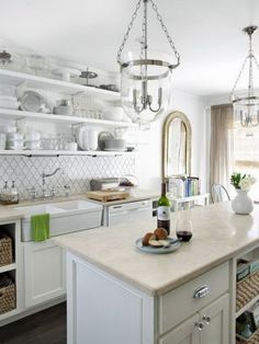 Notice layers of whites. Whiter cabinets and sink, more tan counter, gray whites in backsplash.