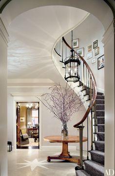 The renovated entry-way of a Manhattan duplex   archdigest.com