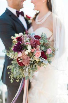 Gorgeous protea bouquet: http://www.stylemepretty.com/new-york-weddings/new-york-city/brooklyn/2015/06/17/a-stunning-burgundy-wedding-in-brooklyn/ | Photography: Haley Sheffield - http://haleysheffield.com/