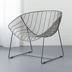 "<span class=""copyHeader"">live wire.</span> Antiqued powdercoated iron ebbs and flows an undulating grid of surprisingly comfortable contours. Handcrafted to graphic extreme, industrial frame spans a generous seat and back that subtly curve in a single contoured swoop. Showing the mark of a metalsmith with exposed brass handwelding at each crosspoint, chair lounges low and deep with a fluid waterfall at the knee. Sits squarely on sleigh legs with stability bar. Up the cush factor with agency…"