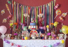 Mila's 1st Candyland | CatchMyParty.com the backdrop & the candy garland in front of table