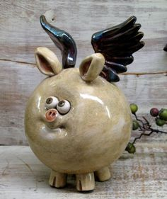 When Pigs Fly - Is this cute or what?  Piggy Bank  Hand made Ceramic Flying Pig  Raku by Heidishoppe, $58.00