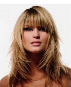 Shoulder+Length+Layered+with+Bangs | woman with shoulder length blond layered hair and bangs