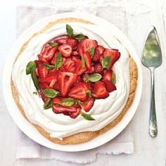 Strawberry shortcake never tasted so good -- or so nuanced. Heavy cream is steeped with basil then whipped, infusing it with its essence. Cover the cream with plastic wrap while it steeps to ensure that the basil flavor doesn't evaporate.