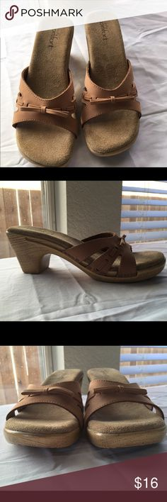 """Tan Leather Slip-On Heeled Sandals Tan leather upper with bow accent.  Manmade heel.  1"""" front heel, 2.75"""" back heel.  Upper in excellent condition.  No defects.  Minor wear on sole.  Feels like best fit would be a 7.5 or smaller/narrow 8.  Love the shoes but not the price, I'm open to (reasonable) offers! Strictly Comfort Shoes Sandals"""