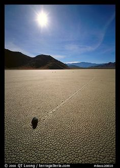 Tracks and moving rock on the Racetrack, mid-day. Death Valley National Park, California, USA.