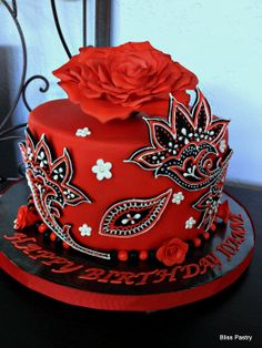 Black and red embroidery cake