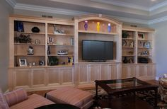 The arched detailing over the TV is perfect for this room!