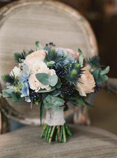 Coral, sage, and dusty blue bridal bouquet   Photo by Ann-Kathrin Koch Photography via http://junebugweddings.com/wedding-blog/coral-sage-wedding-babington-house/