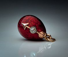Eternity Egg by Carl Faberge antique miniature egg charm.  Perfect.  And with an arrow! Is it meant for a Sagittarius.