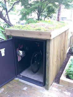 Integral bike security in the garden from Asgard - bike locker with rooftop garden – only instead, a kayak shed with a green roof! Garden Bike Storage, Outdoor Bike Storage, Shed Storage, Kayak Storage, Small Storage, Small Garden Storage Ideas, Small Garden With Shed, Tool Storage, Garage Storage