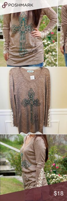 NEW Southern Grace God is Love Woven Top NEW with tags. Runs a little smaller. Lightweight woven sweater material. Reasonable offers accepted via offer button only. No trades. I strive to maintain good feedback. I'm a real person. If for any reason you are unhappy with your purchase, please contact me. Southern Grace Boutique Tops