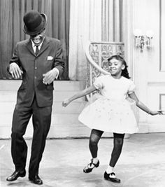 "Jonelle Allen (born 1944, american actress, singer, and dancer), joins Sammy Davis Jr. on host Walter Winchell's TV variety show, in a take-off of the Shirley Temple/Bill ""Bojangles"" Robinson tap dance routines in 1935 film, ""The Little Colonel."""