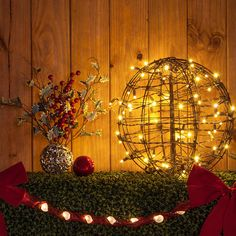 Christmas light ball with warm white led lights. Hang light balls from the porch, use as tabletop decorations or topiaries!