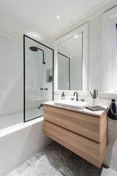 TOP 10 minimal & NATURAL bathrooms Bathroom with light wood and black trim. White tile bathroom with clear glass. Marble Bathroom with white and black, White Bathroom Tiles, Wood Bathroom, Bathroom Renos, Laundry In Bathroom, Bathroom Layout, Modern Bathroom, Small Bathroom, Bathroom Showers, Modern Shower
