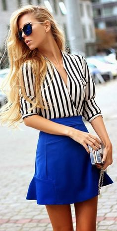 Shop this look on Lookastic:  https://lookastic.com/women/looks/white-and-black-long-sleeve-blouse-blue-a-line-skirt-silver-clutch-navy-sunglasses/13201  — Navy Sunglasses  — White and Black Vertical Striped Long Sleeve Blouse  — Blue A-Line Skirt  — Silver Clutch