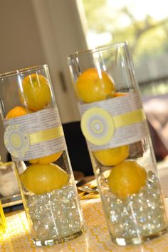 Lemons in vases table decor. MM colors some other fruit/plant thing?