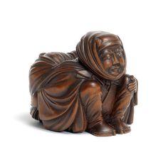 A large wood okimono-style netsuke of a man   By Ryukei, Meiji Period