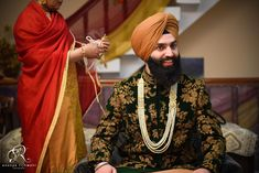 How dapper is this Sikh groom in a royal black and gold sherwani styled with pearl strings.