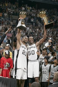Tim Duncan and David Robinson: The end of their time as the Twin Towers of the NBA, as Robinson would retire after the Spurs won this championship in 2003.